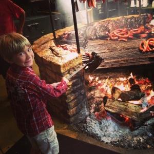 Ezra workin' the smoke pit at world famous Salt Lick BBQ near Austin, TX.